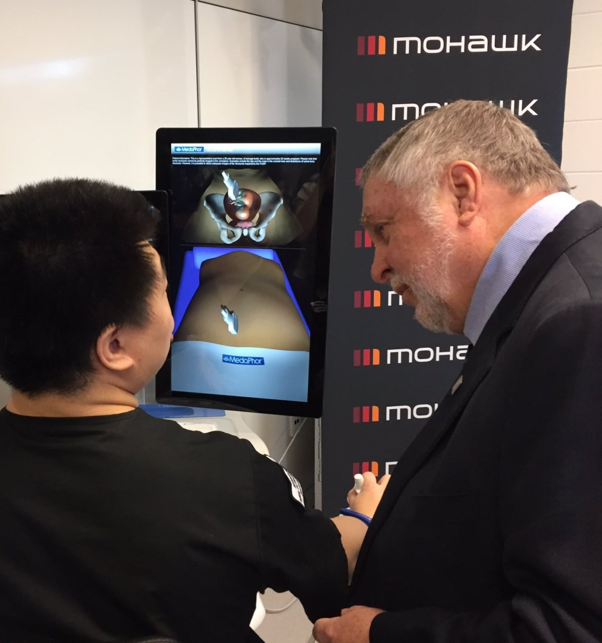 MPP Ted McMeekin speaks with Mohawk College student about 3D imaging technology at the Centre for Health Care simulation.