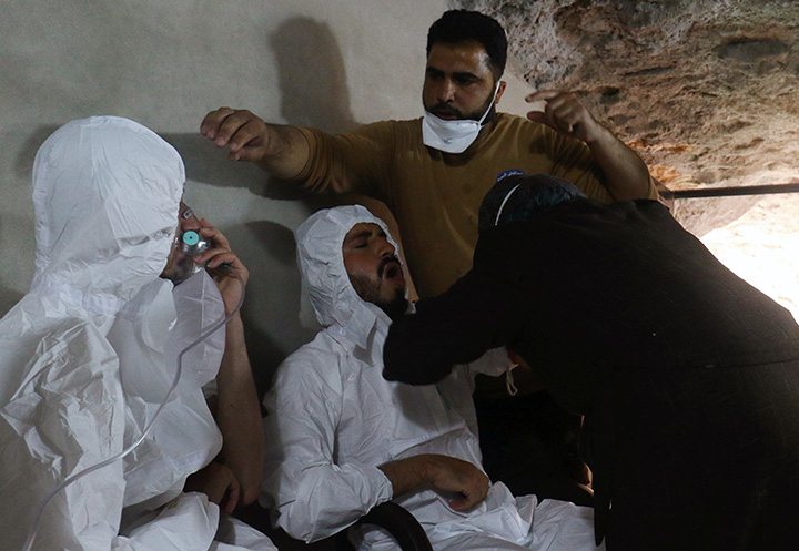 A man breathes through an oxygen mask as another man receives treatments, after what rescue workers described as a suspected gas attack in the town of Khan Sheikhoun in rebel-held Idlib, Syria April 4, 2017. Syria has formally requested a UN investigation into the attack.