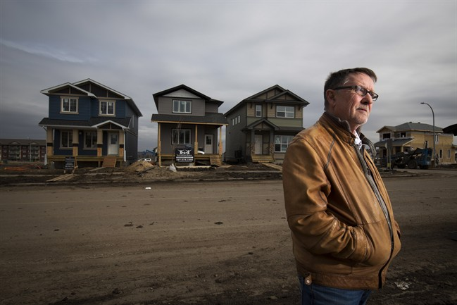 Gilles Huizinga president of the local Urban Development Institute and a homebuilder with Sedgewood Homes with newly built homes in the Timberlea area that was destroyed by wildfires last year in Fort McMurray, Alta. Thursday, April 20, 2017.