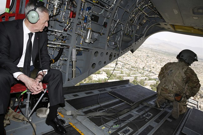 U.S. Defense Secretary Jim Mattis looks out over Kabul as he arrives via helicopter at Resolute Support headquarters in Kabul, Afghanistan Monday, April 24, 2017. U.S. officials are suggesting that Russia is arming the Taliban.