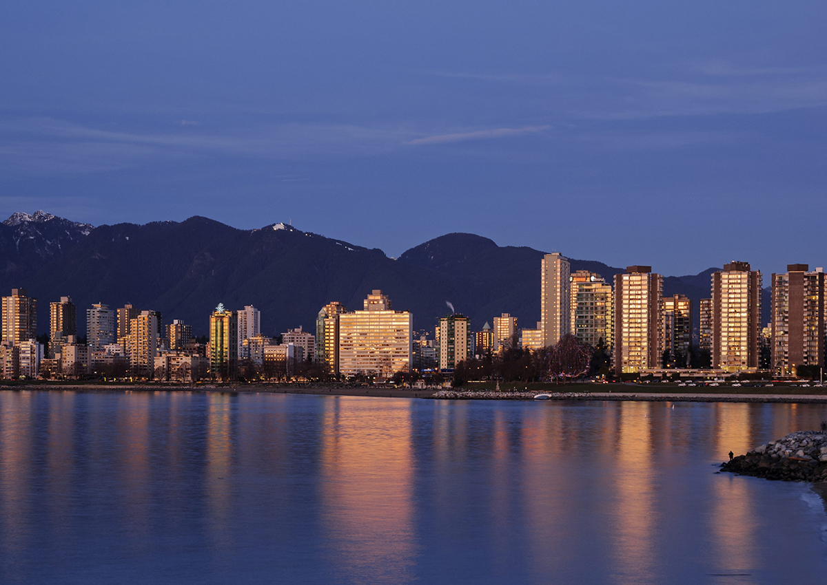 A colourful sunset is reflected in English Bay by the high-rise buildings of Vancouver's West End district, January 5, 2014.