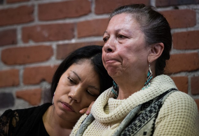 Lorelei Williams, left, rests her head on Michelle Pineault's shoulder as they listen during a Coalition on Missing and Murdered Indigenous Women and Girls news conference, in Vancouver, B.C., on Monday April 3, 2017.