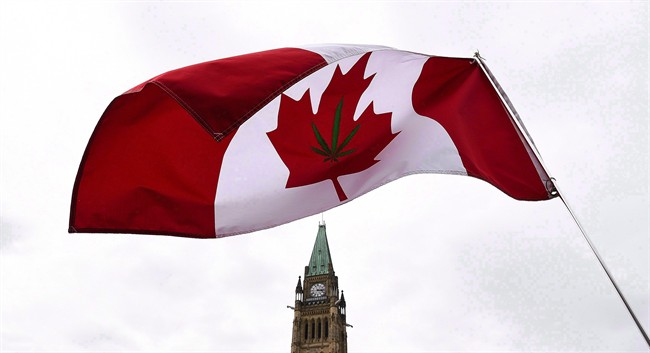 A Canadian flag with a marijuana leaf on it flies during a 4/20 rally on Parliament Hill in Ottawa on April 20, 2017.