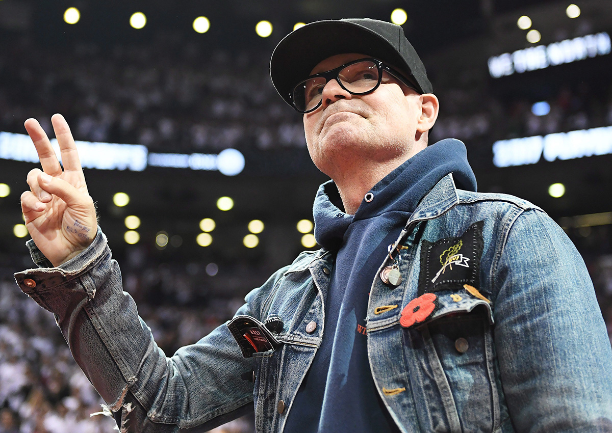 The Tragically Hip lead singer Gord Downie salutes fans during the first half of game three of an NBA playoff series basketball game between the Toronto Raptors and Cleveland Cavaliers in Toronto on Friday, May 5, 2017.