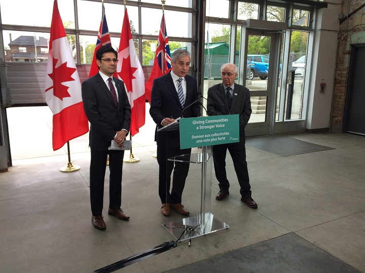 Municipal Affairs Minister Bill Mauro (centre) and Attorney General Yasir Naqvi (left) make an announcement at Artscape Wychwood Barns in Toronto on May 16, 2017.