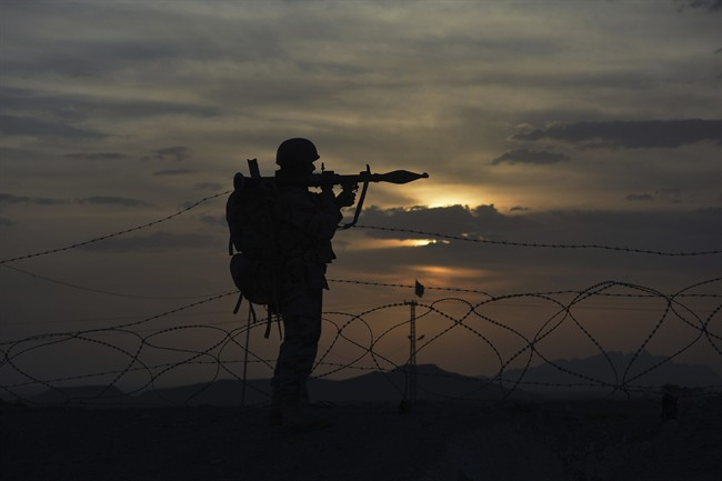 A Pakistani border security guard stands alert at Pakistan-Afghanistan border post, Chaman in Pakistan.