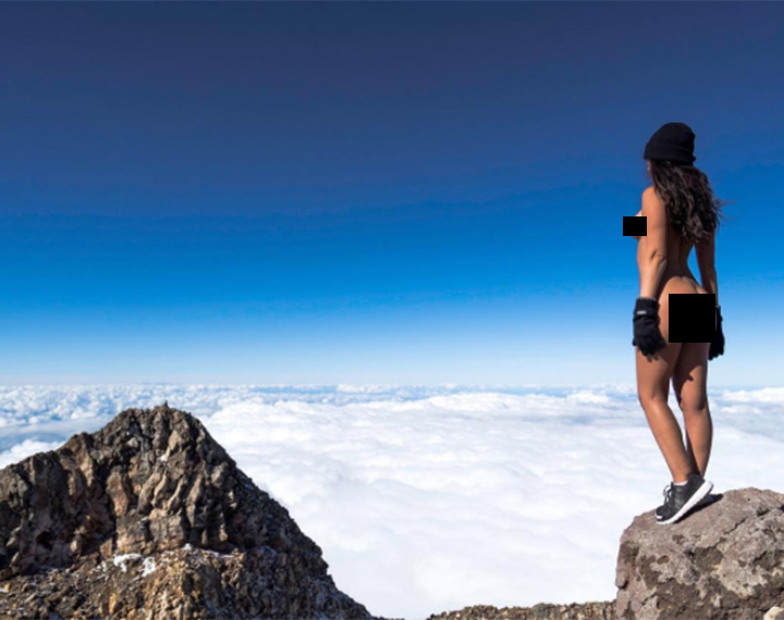 Jaylene Cook poses for a photo at the summit of Mount Taranaki in New Zealand.