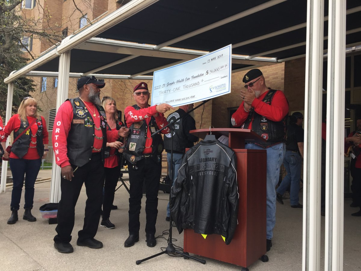 Members of the 1st Canadian Army Veterans Motorcycle Unit present a cheque to St. Joseph's Health Care Foundation on May, 13, 2017.