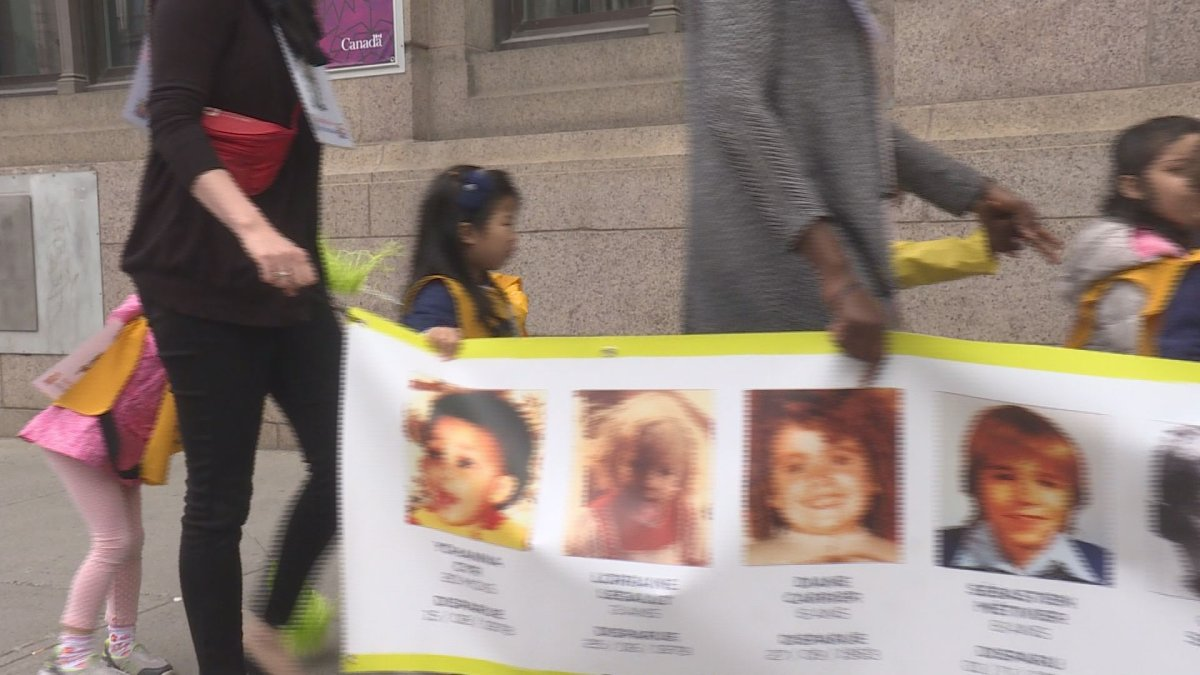 Daycare children walk to remember missing kids, Thursday, May 25, 2017.