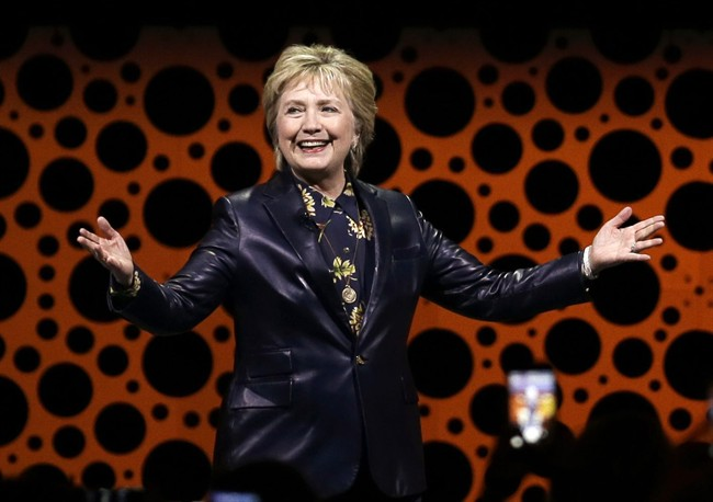 Former Secretary of State Hillary Clinton gestures while speaking before the Professional Businesswomen of California in San Francisco.