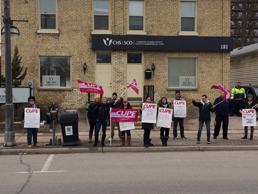 Workers protest outside the London branch of the Canadian Hearing Society on March 6, 2017.