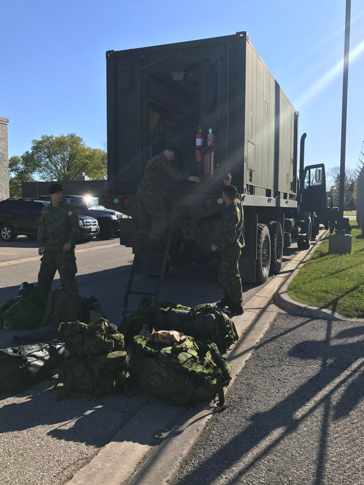 Reservists from 31 Canadian Brigade Group load and marshal vehicles in at Wolseley Barracks, London, in preparation of their move to Kingston, where they will be prepared to support in flood relief when they receive the request for assistance, on 8 May 2017.