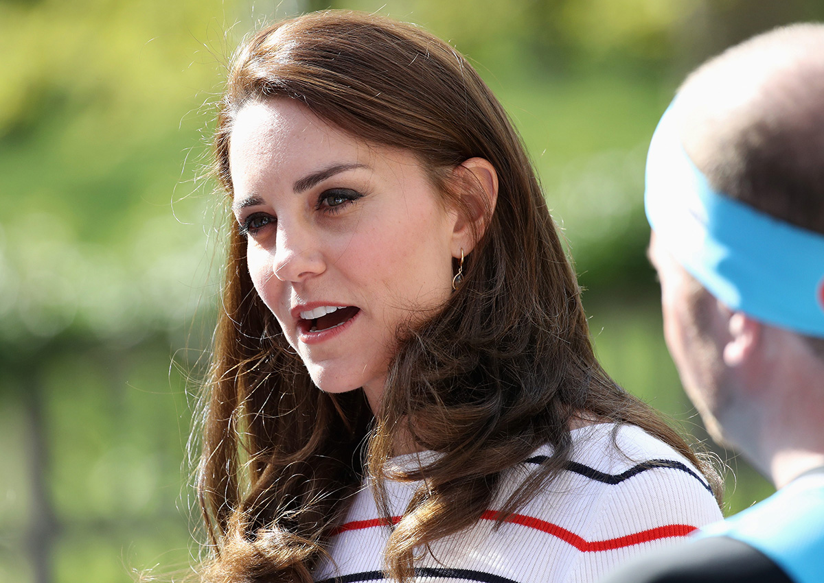 Catherine Duchess of Cambridge speaks with runners from Team Heads Together ahead of the 2017 Virgin Money London Marathon.