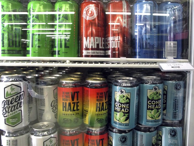 Different varieties of Vermont craft beer sit in a store cooler at Mehuron's Market on Tuesday, May 9, 2017,.