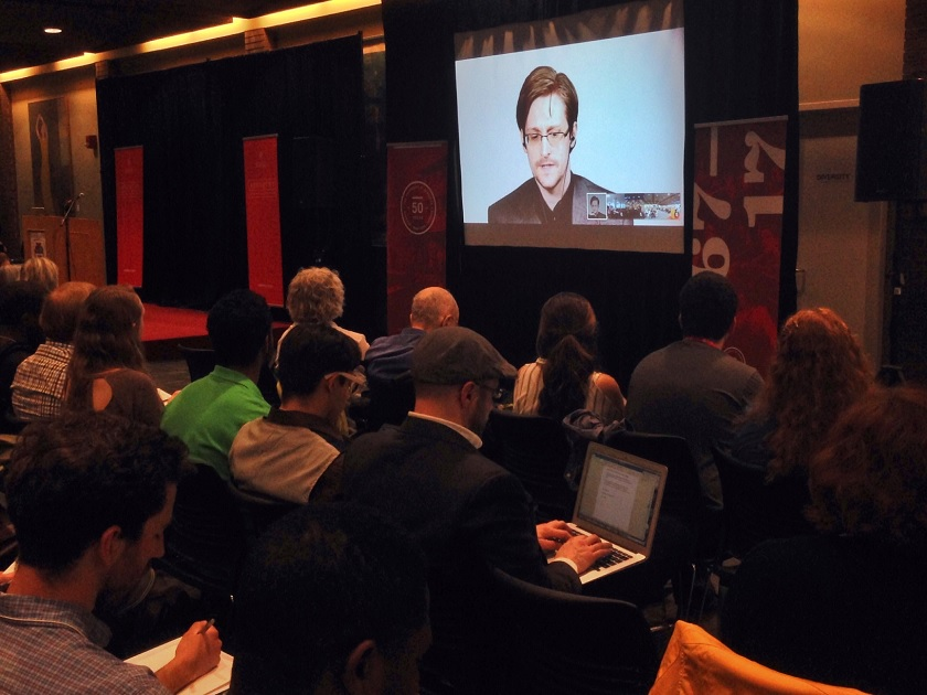 Edward Snowden speaks to students at the University of Winnipeg Tuesday night via web link.