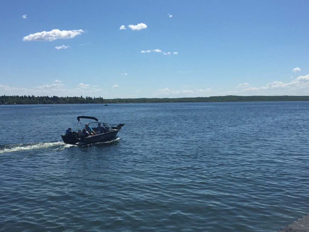 Search and rescue crews are combing Lake Wabamun for a man who disappeared while swimming July 24, 2021.