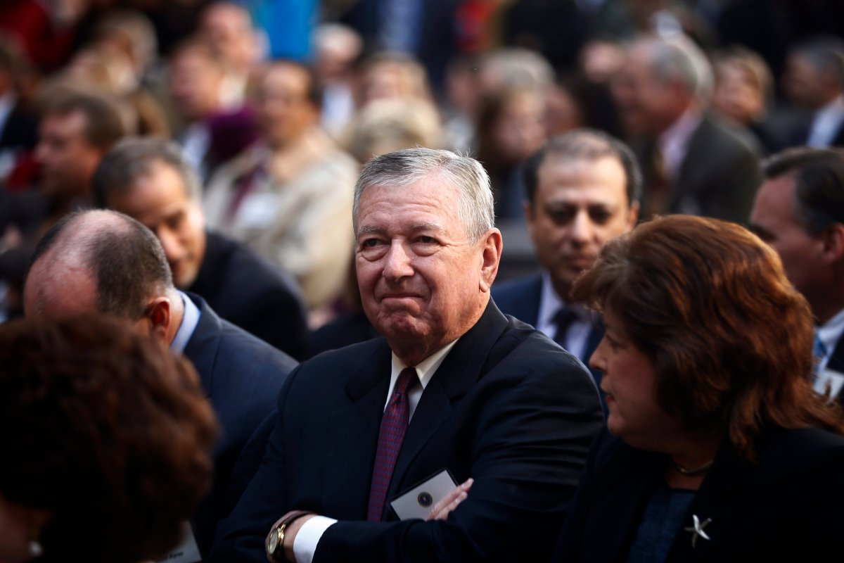 Former Attorney General John Ashcroft is seated before President Barack Obama and James Comey arrive for Comey's installation ceremony as FBI director, Monday, Oct. 28, 2013, at FBI Headquarters in Washington.