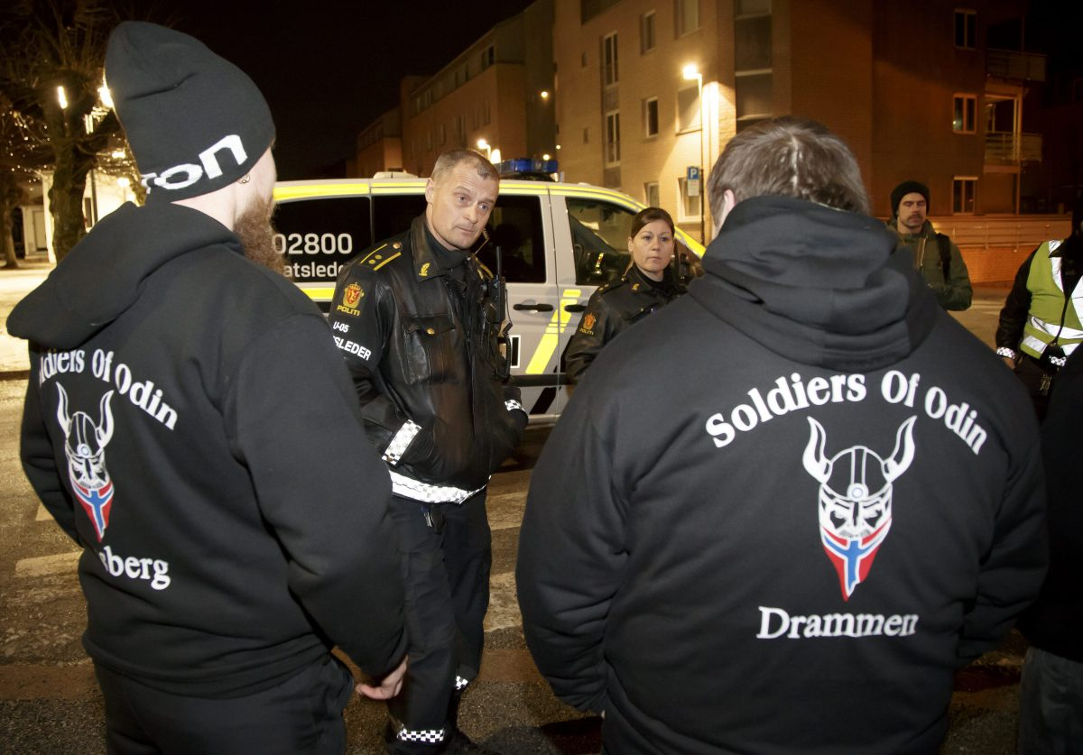 Members of the 'Soldiers of Odin' are checked by Norwegian police for their ID and if they are carrying any weapons, while on patrol in the streets of Drammen, Norway, overnight 21 February 2016.