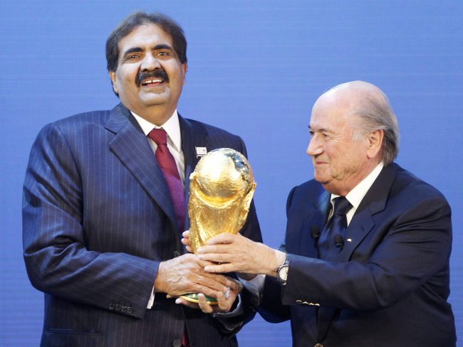 In this Thursday, Dec. 2, 2010 file photo, Sheikh Hamad bin Khalifa Al-Thani, Emir of Qatar, left, gets the World Cup trophy by FIFA President Joseph Blatter, right, after the announcement of Qatar hosting the 2022 soccer World Cup in Zurich, Switzerland.