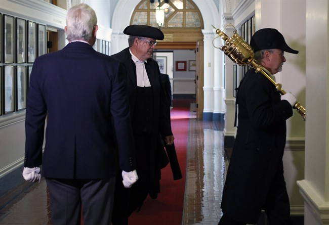 Speaker of the B.C. Legislature Steve Thomson is lead by the Sergeant-of-Arms, to start of the debate in Victoria, B.C., on Monday, June 26, 2017.
