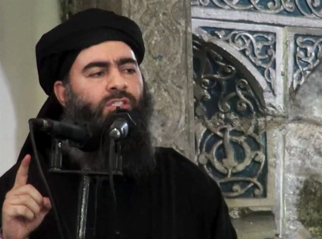 This July 5, 2014 file image purports to show the leader of the Islamic State group, Abu Bakr al-Baghdadi, delivering a sermon at a mosque in Iraq.
