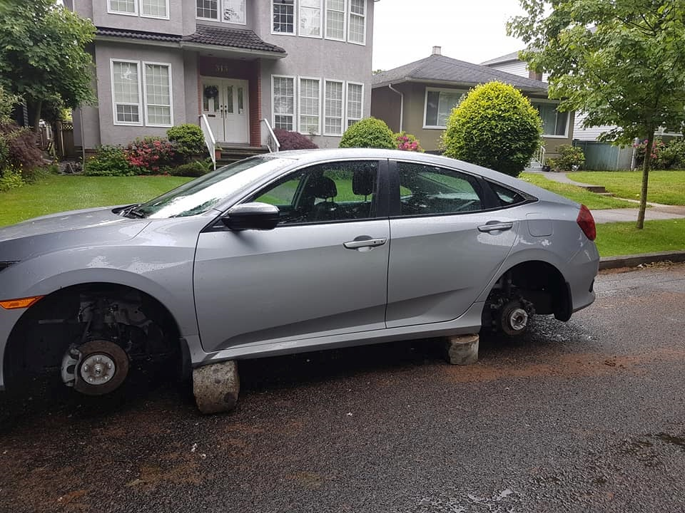 2 wheels stolen from car parked in Vancouver in what police call unusual theft - image