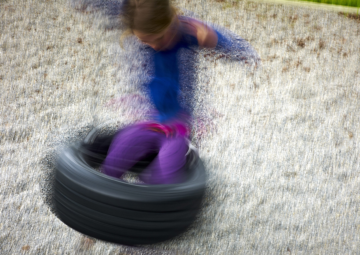 FILE PHOTO: A child plays on a tire swing at a playground Alberta.