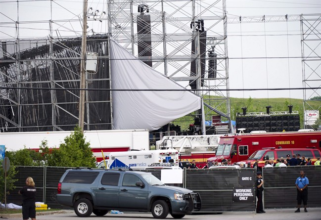 Emergency personnel are on scene near a collapsed stage at Downsview Park in Toronto on Saturday, June 16, 2012.