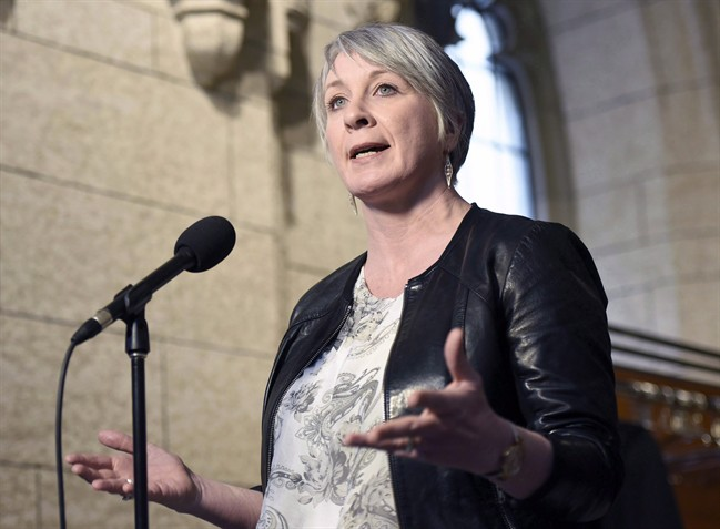 Federal Labour Minister Patty Hajdu speaks to reporters during a weekend meeting of the national caucus on Parliament Hill in Ottawa on Saturday, March 25, 2017.