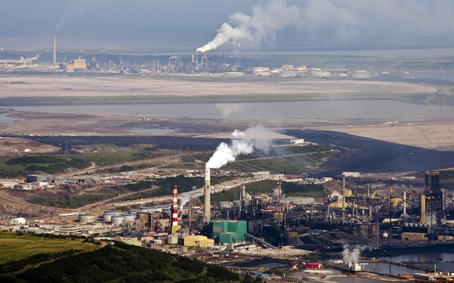 The Suncor oil sands facility seen from a helicopter near Fort McMurray, Alta., Tuesday, July 10, 2012.