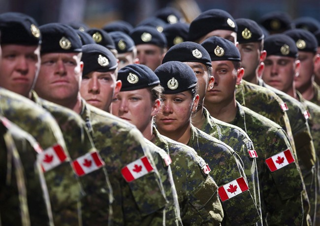 Members of the Canadian Armed Forces march during the Calgary Stampede parade in Calgary, Friday, July 8, 2016.