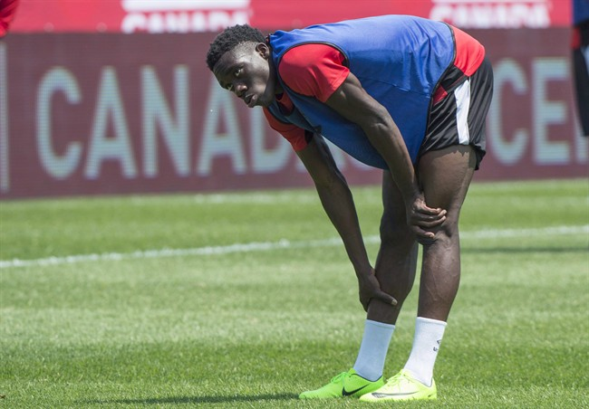 Canada's Alphonso Davies stretches during a practice Monday, June 12, 2017 in Montreal. Vancouver Whitecaps rising star Davies headlines a young Canadian squad for the 2017 CONCACAF Gold Cup.