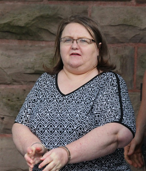 Elizabeth Wettlaufer is escorted by police from the courthouse in Woodstock, Ont, Monday, June 26, 2017. Wettlaufer, a former Ontario nurse who murdered eight seniors in her care, was sentenced Monday to life in prison with no eligibility for parole for 25 years.