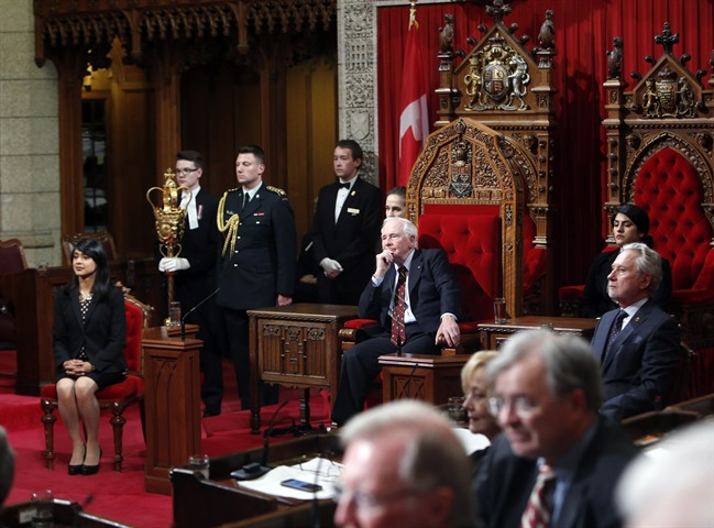 Governor General David Johnston takes part in Royal Assent along with Senator Peter Harder, right, and Bardish Chagger Leader of the Government in the House of Commons, in the Senate on Parliament Hill in Ottawa on Monday, June 19, 2017.