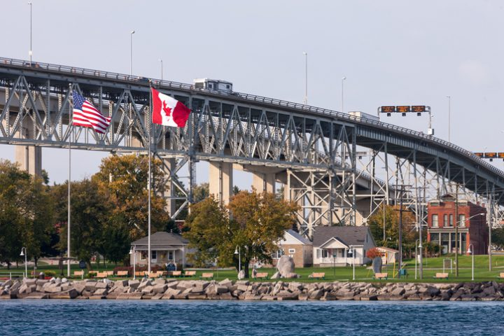 The Bluewater Bridge spanning the St. Clair River connects Sarnia Ontario, Canada, to Port Huron Michigan, USA.