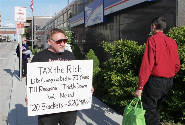 FILE - In this April 17, 2012, photo, James Hodgkinson of Belleville protests outside of the U.S. Post Office in Belleville, Ill. The suspect in the Virginia shooting that injured Rep. Steve Scalise and several others has been identified as Hodgkinson.
