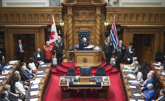 FILE PHOTO: British Columbia Premier Christy Clark, left, and NDP leader John Horgan, right, look on as B.C. Lieutenant Governor Judith Guichon gives the Speech from Throne in Victoria, Thursday, June 22, 2017.