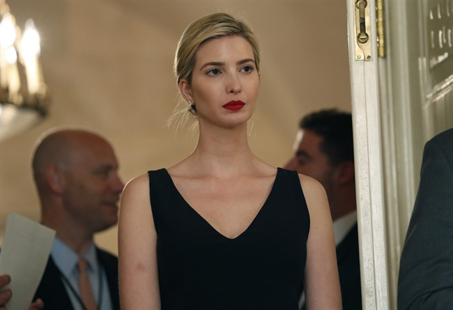 In this Friday, June 2, 2017 file photo, Ivanka Trump, the daughter and assistant to U.S President Donald Trump, stands in the doorway as President Donald Trump speaks before signing bills in the Diplomatic Reception Room at the White House, in Washington.