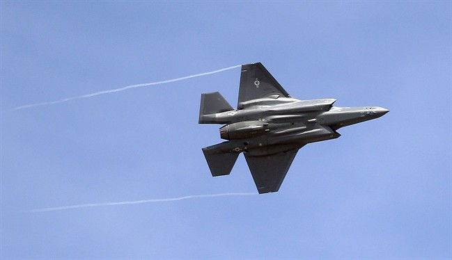 In this Wednesday, Sept. 2, 2015, file photo, an F-35 jet arrives at its new operational base at Hill Air Force Base, in northern Utah.