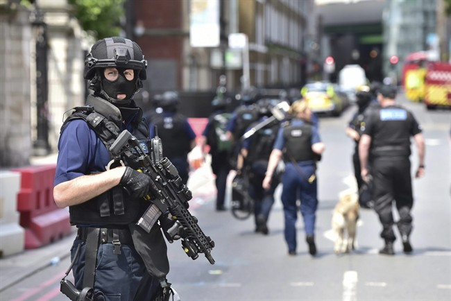 Armed police on St Thomas Street, London, Sunday June 4, 2017, .