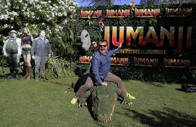 """Actors Jack Black, right, and Nick Jonas pose to the media during a photocall to promote the film """"Jumanji: Welcome to the jungle"""" in Barcelona, Spain, Sunday, June 18, 2017."""