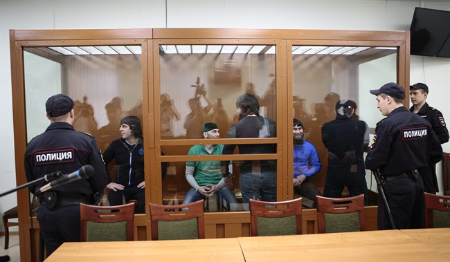 Defendants suspected of involvement in the killing of opposition leader Boris Nemtsov, stand in a glass enclosure during their trial in Russia, June 27.