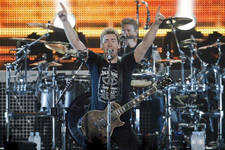 Nickelback's Chad Kroeger on stage.