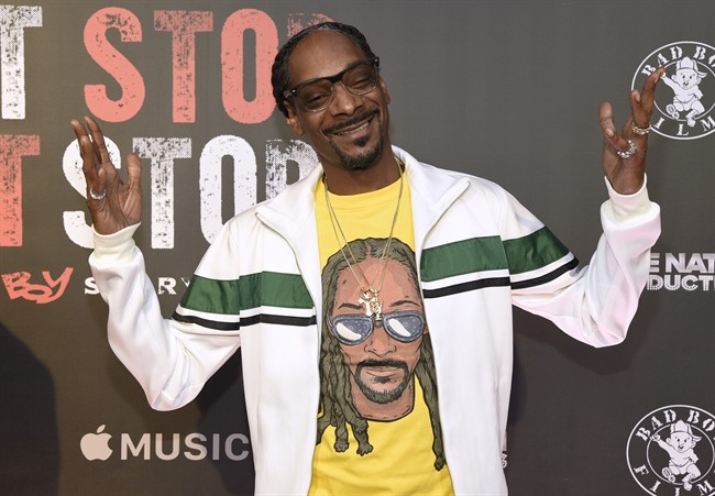 "FILE - In this Wednesday, June 21, 2017, file photo, Snoop Dogg arrives at the Los Angeles premiere of ""Can't Stop, Won't Stop: A Bad Boy Story"" at the Writers Guild Theater on in Beverly Hills, Calif."