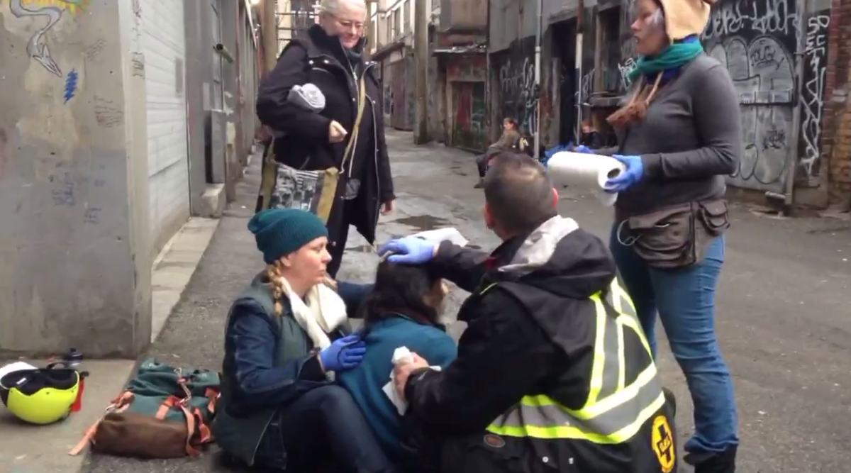 Civilian volunteers in the DTES attend to another overdose.