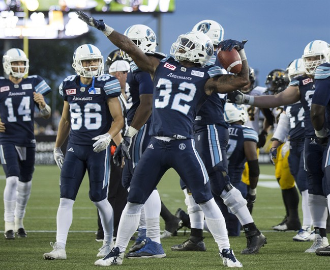Toronto Argonauts running back James Wilder Jr. (32) celebrates his touchdown against the Hamilton Tiger-Cats, in Hamilton on Friday, June 16, 2017.