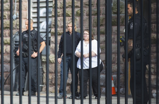 Elizabeth Wettlaufer is escorted from the Provincial courthouse in Woodstock, Ont., on Thursday, June 1, 2017.