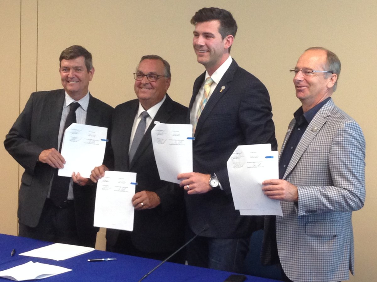 Edmonton International Airport president and CEO Tom Ruth, City of Leduc Mayor Greg Krischke, Leduc County Mayor John Whaley and Edmonton Mayor Don Iveson sign the annexation agreement June 30, 2017 between Edmonton and Leduc County.
