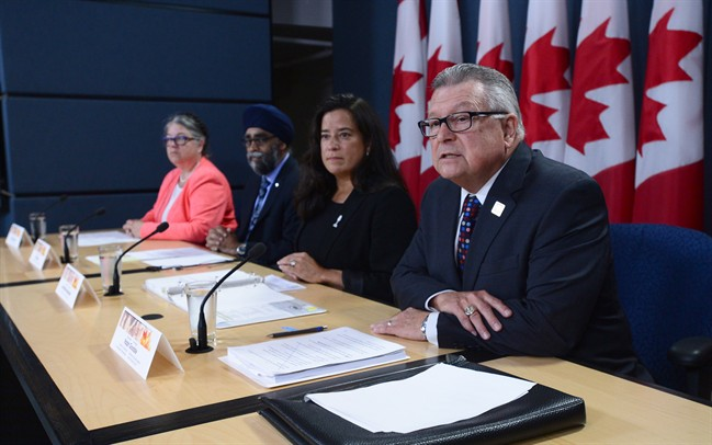 Ralph Goodale, Minister of Public Safety and Emergency Preparedness, Jody Wilson-Raybould, Minister of Justice, Harjit Sajjan, Minister of National Defence, and Diane Lebouthillier, Minister of National Revenue, make a national security-related announcement at the National Press Theatre in Ottawa on Tuesday, June 20, 2017.