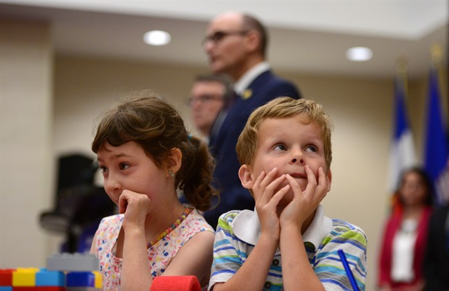 """Bryson Boyce-Pettes, 5, right, and Eleonore Alamillo-Laberge, 6, take part in a press conference as Social Development Minister Jean-Yves Duclos and P.E.I. Minister of Education, Doug Currie, speak as federal-provincial and territorial ministers responsible for """"Early Learning and Child Care"""" meet in Ottawa on Monday, June 12, 2017."""